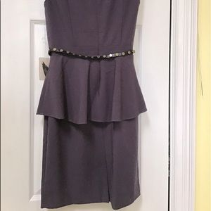 Peplum style plum colour dress.